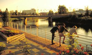 People enjoying evening on banks of Chena River