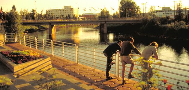 People enjoying evening on banks of Chena River
