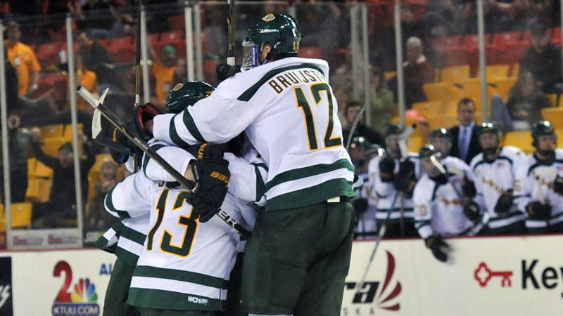 hockey players unite in group huddle as they win the kendall ice classic in 2011 westmark hotels