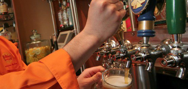 Bartender pouring a beer from the tap at the Solstice Cafe Westmark Anchorage