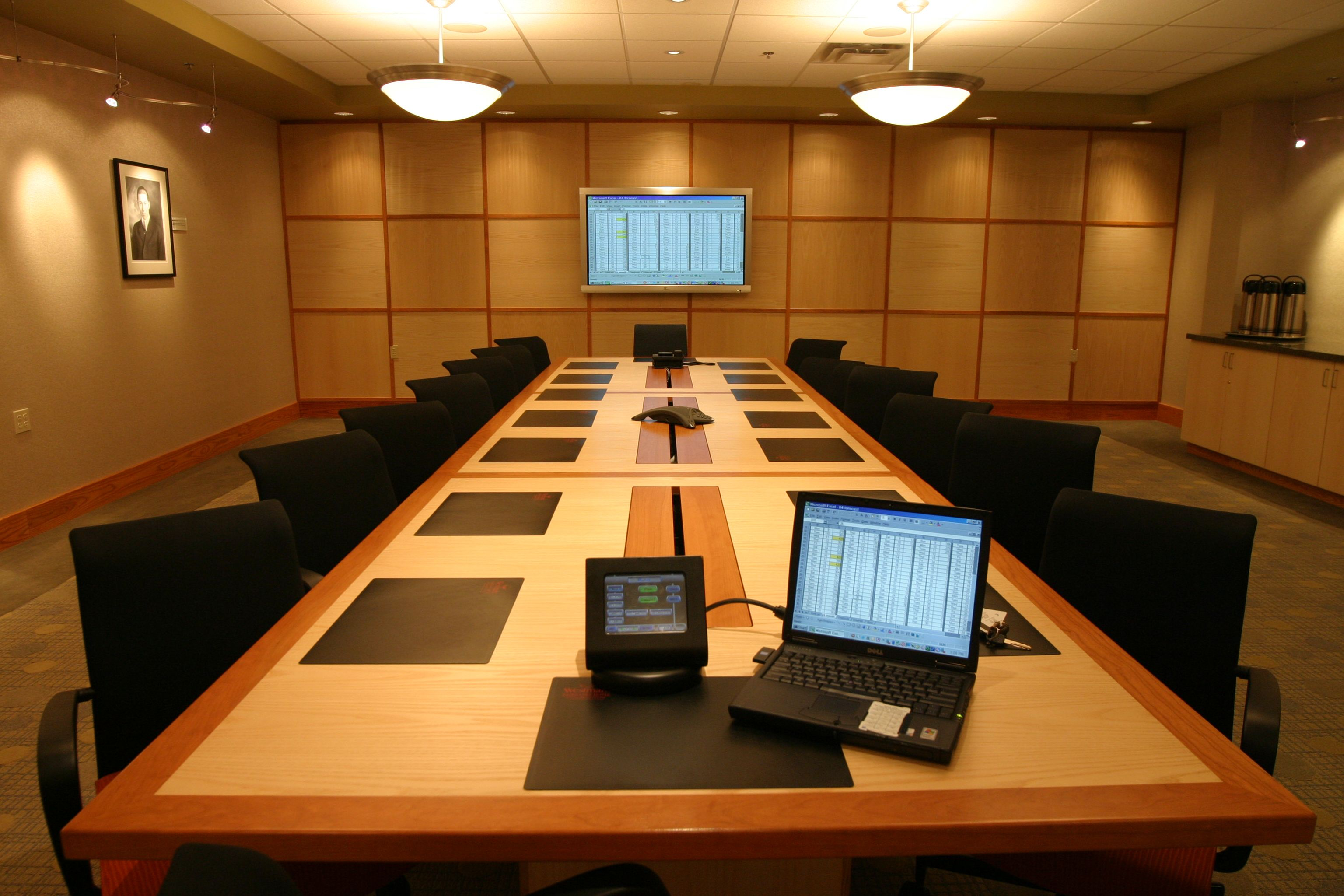 Westmark Fairbanks Hotel & Conference Center Boardroom with long boardroom table, chairs and computer with screen against back wall