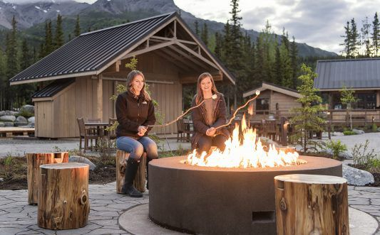 SMALL_Property - Guests around firepit at Denali Square at McKinley Chalet mc_04