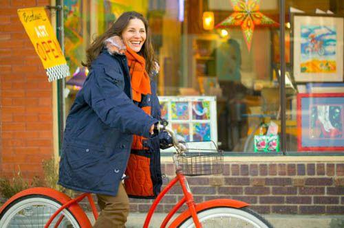 Woman Riding Bike in Alaska