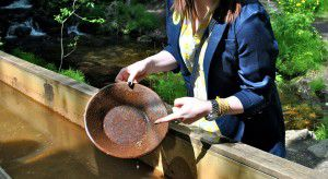 Woman gold panning in Alaska, Westmark Hotels